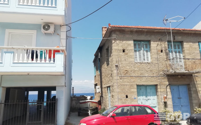 Seafront traditional stone house for sale in Derveni Village